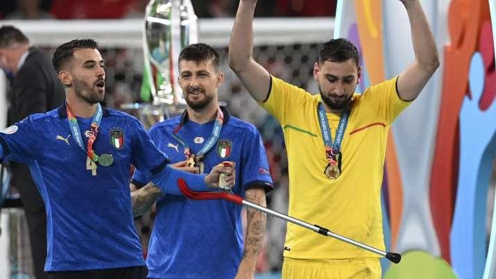 Italy's goalkeeper Gianluigi Donnarumma and his teammate