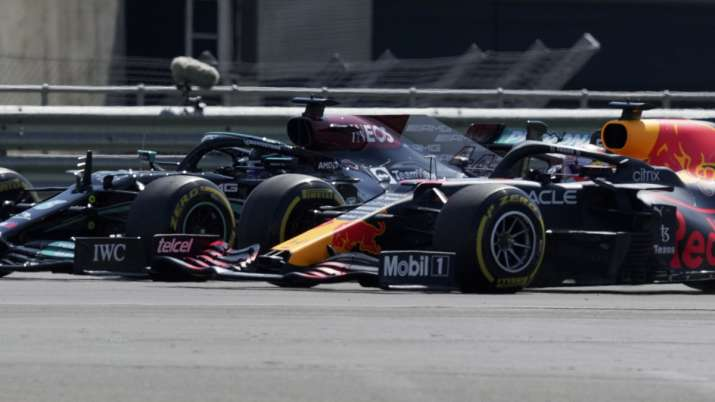Mercedes driver Lewis Hamilton of Britain, left, and Red