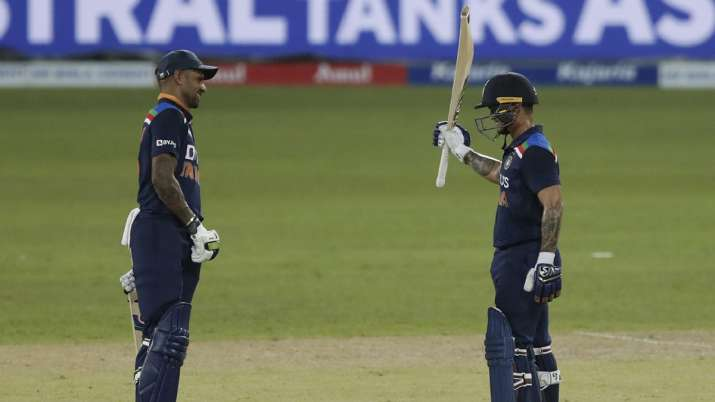 India's Ishan Kishan, right, celebrates scoring a half