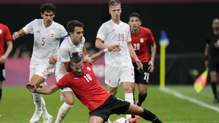 Egypt's Ramadan Sobhi falls challenged by players from Spain