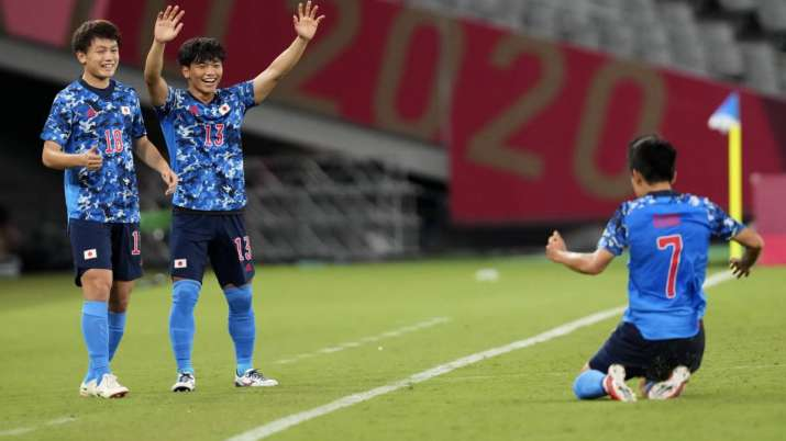Japan's Ritsu Doan, left, and teammate Reo Hatate, second from left, celebrates a goal from Takefusa