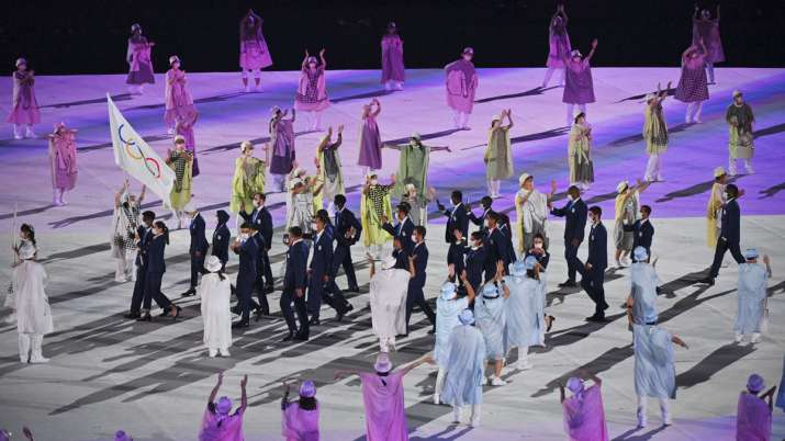 The refugee team carry the Olympic flag during the opening