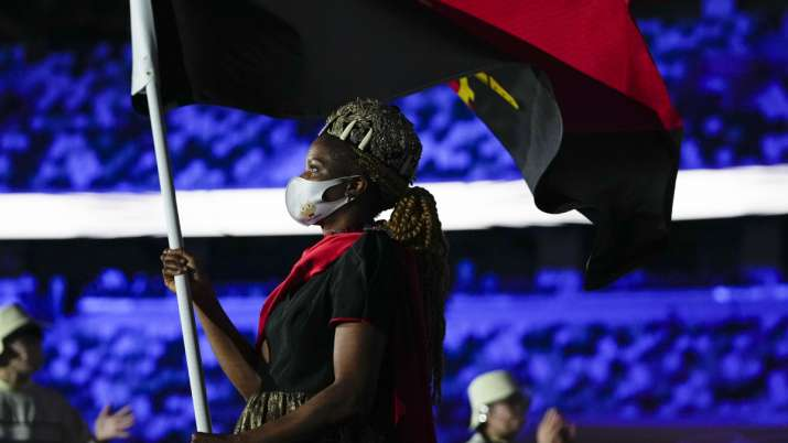 Natalia Santos of Angola, carry her country's flag during