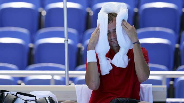Daniil Medvedev, of the Russian Olympic Committee, cools