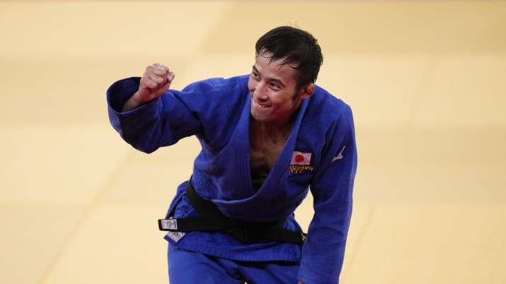 Naohisa Takato, of Japan, celebrates after defeating Yang