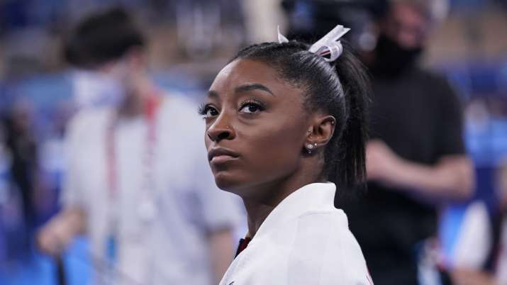 Simone Biles, of the United States, waits for her turn to