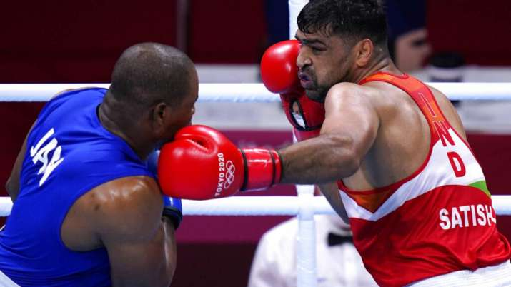 Satish Kumar, right, of India exchanges punches with Ricardo Brown of Jamaica
