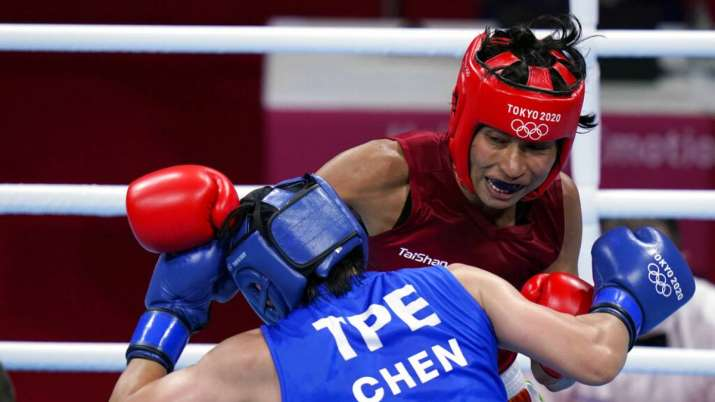 Lovlina Borgohain, of India, in red, delivers a punch to Nien-Chin Chen