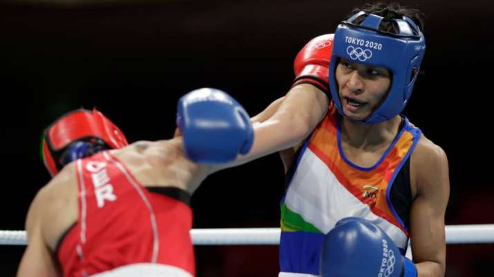 Nadine Apetz (red) of Germany exchanges punches with Lovlina Borgohain of India