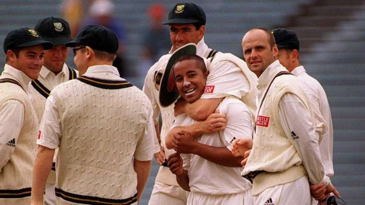 South Africa's Paul Adams receives a hug from his