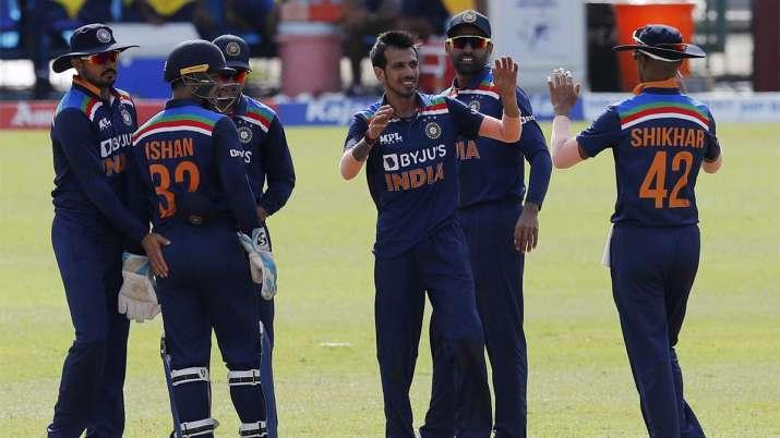 Yuzvendra Chahal, center, celebrates the wicket of Sri