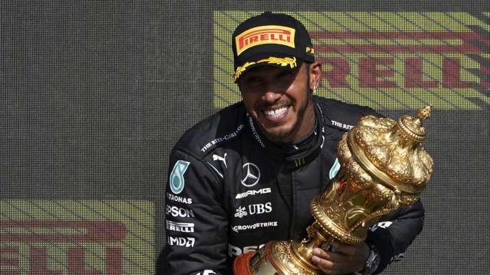 Mercedes driver Lewis Hamilton of Britain celebrates on the