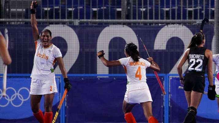 India's Gurjit Kaur celebrates with her teammates after scoring during a women's field hockey semi-f