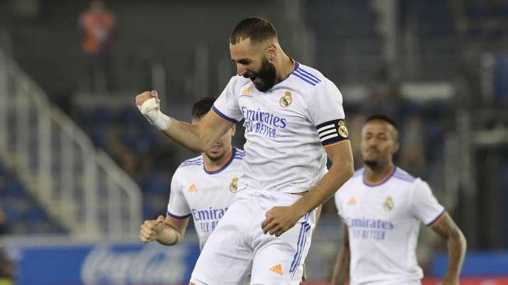 Real Madrid's Karim Benzema celebrates after scoring his