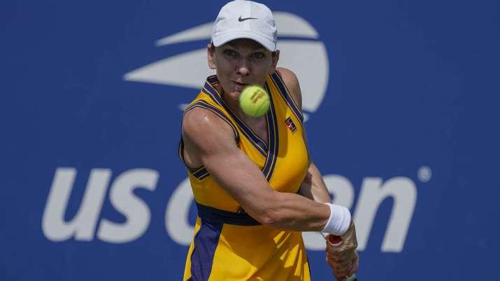 Simona Halep, of Romania, returns a shot to Camila Giorgi,