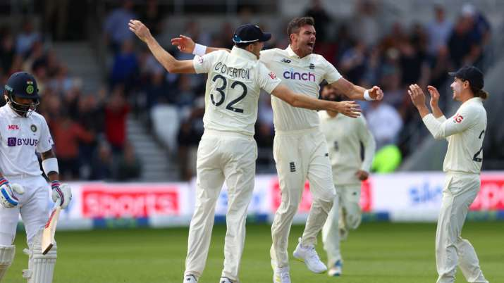 James Anderson of England celebrates with Craig Overton and