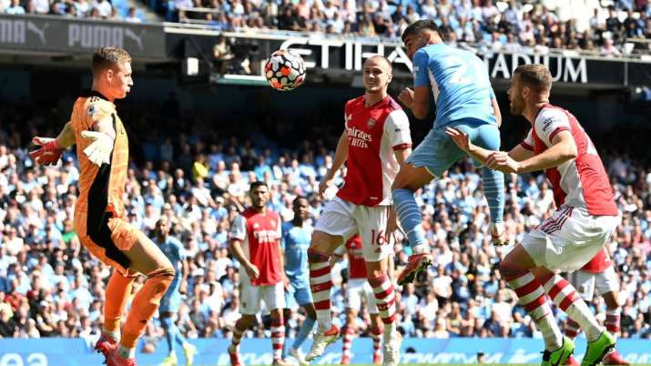 Ferran Torres of Manchester City scores their sides fifth goal past Bernd Leno of Arsenal