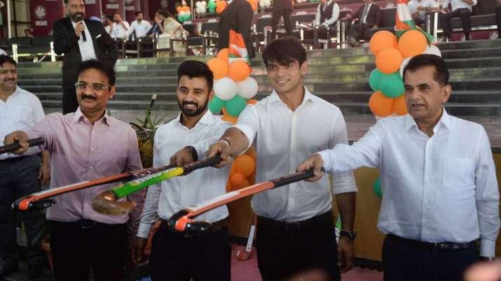 Neeraj Chopra plays hockey with members of Indian men's team