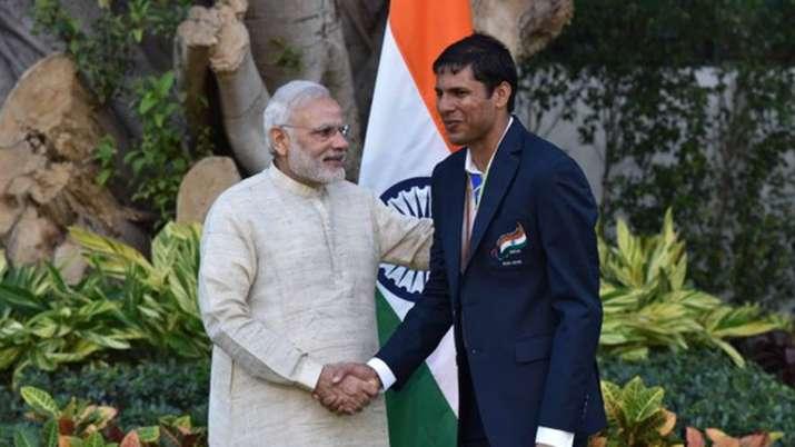 Prime Minister Narendra Modi withDevendra Jhajharia