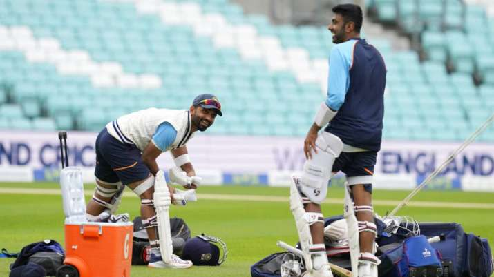 India's Ajinkya Rahane pads up with teammate Ravichandran Ashwin