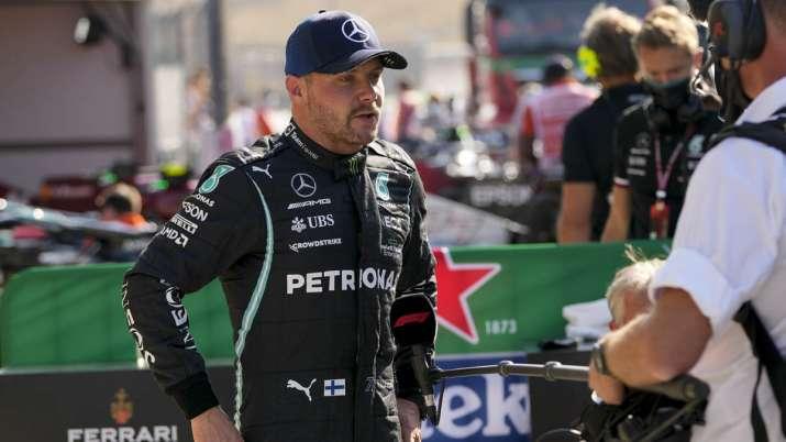 Mercedes driver Valtteri Bottas of Finland answers media's