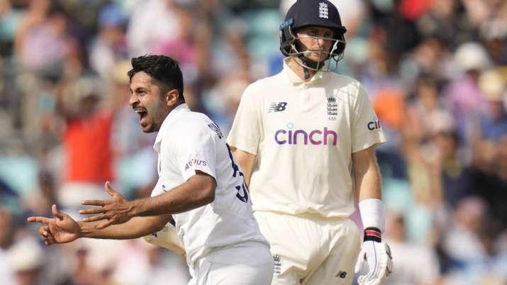 India's Shardul Thakur celebrates taking the wicket of