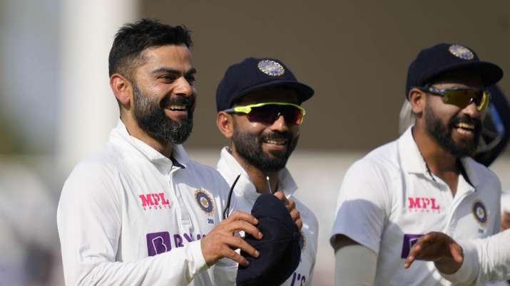 India's captain Virat Kohli smiles as he leaves the pitch