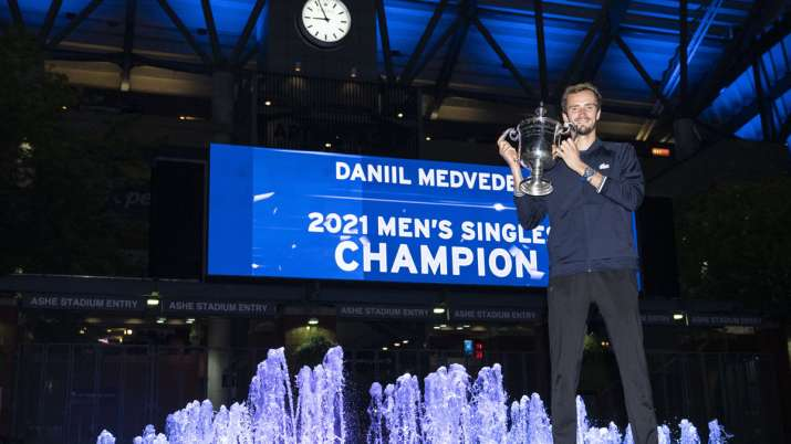 Daniil Medvedev, of Russia, holds up the championship