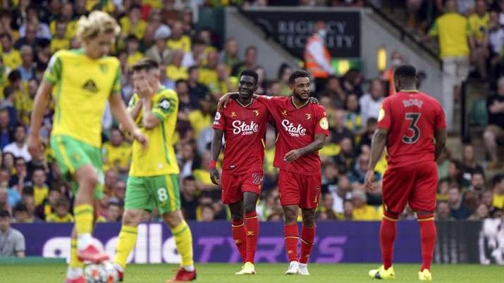 Watford's Ismaila Sarr, center left, celebrates scoring