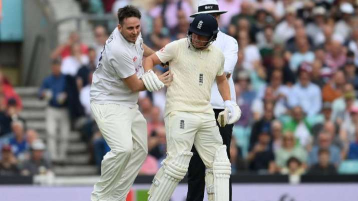 Pitch invader runs into Jonny Bairstow of England