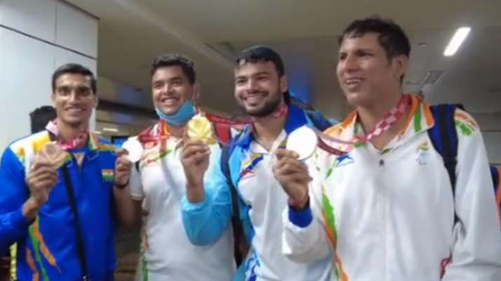 Indian Paralympic medallists return home to tumultuous welcome