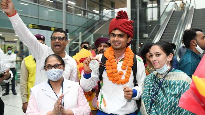 India's history-making Paralympians return to rousing