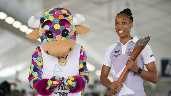 File photo of England netball international Layla Guscoth, right, holding the Commonwealth Games bat