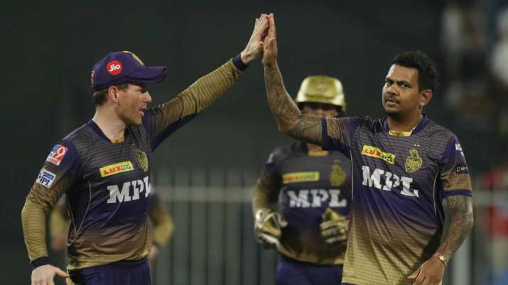 KKR's Sunil Narine (right) celebrates with captain Eoin Morgan after taking an RCB wicket in Sharjah